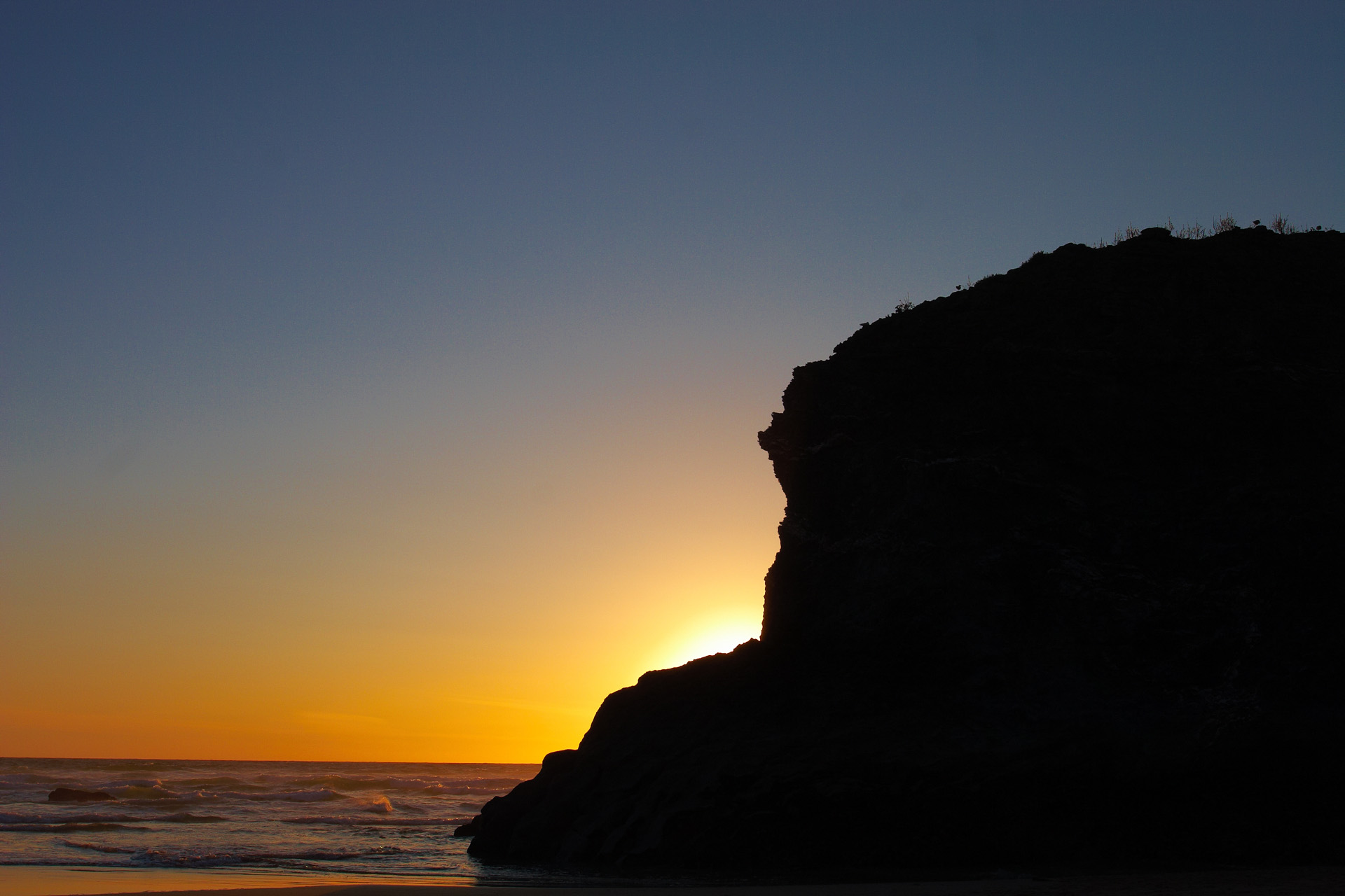 Rock Outcrop at Bedruthan Steps silhouetted against the setting
