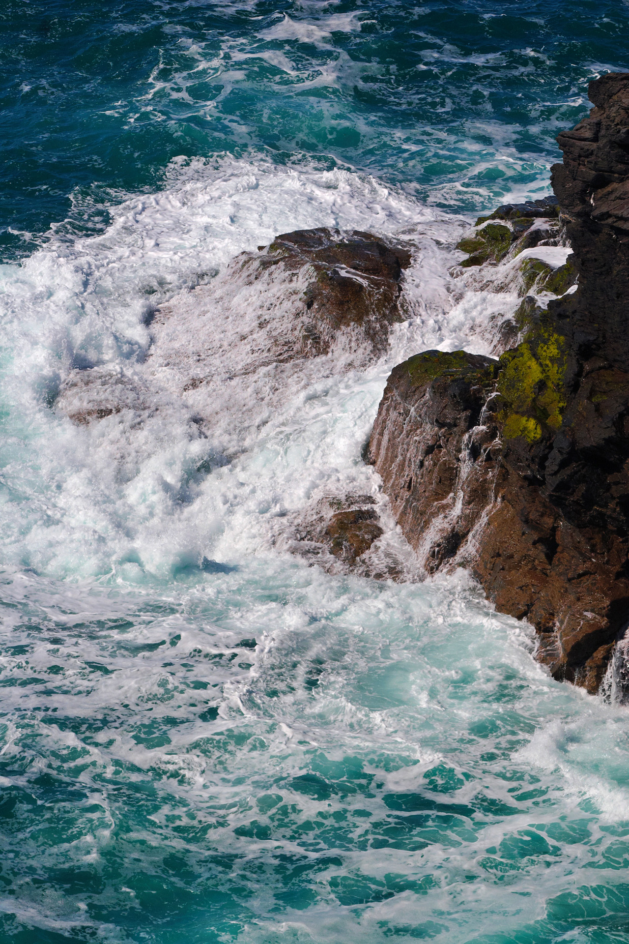 Waves breaking on the rocks at High Cove, Cornwall