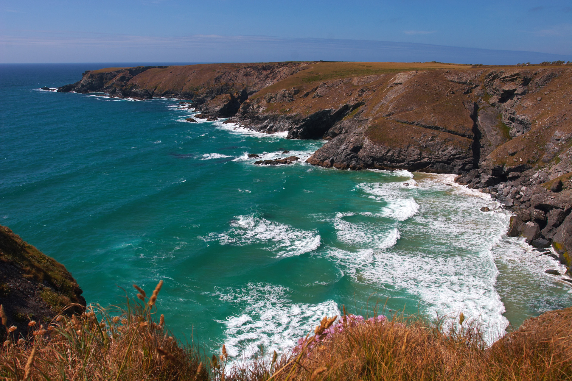 Waves breaking on the beach at Pentire Steps, Cornwall