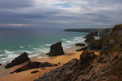 Bedruthan Steps from the cliff top, with a storm brewing out to