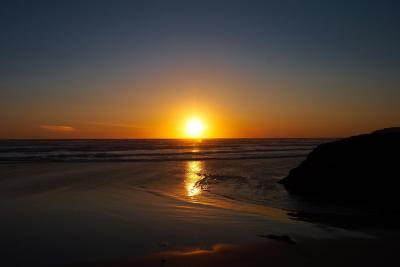 Sunset on the beach at Bedruthan Steps in Cornwall